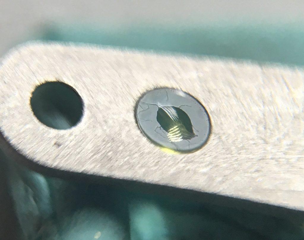 Watch repair Fresh oil on cap jewel